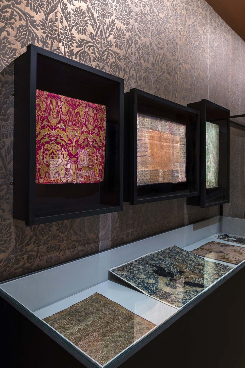 A display of fabric samples from 1912 by Mariano Fortuny (1871-1949), including his signature richly embellished and sumptuous silk velvets