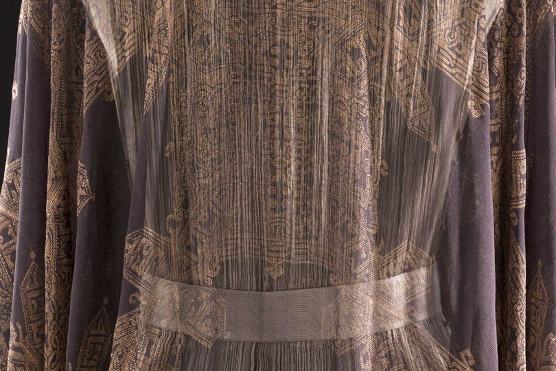 "Detail of the ""Orfeus"" gown by Mariano Fortuny, made in 1910-1911 from silk gauze imprinted with gold thread"