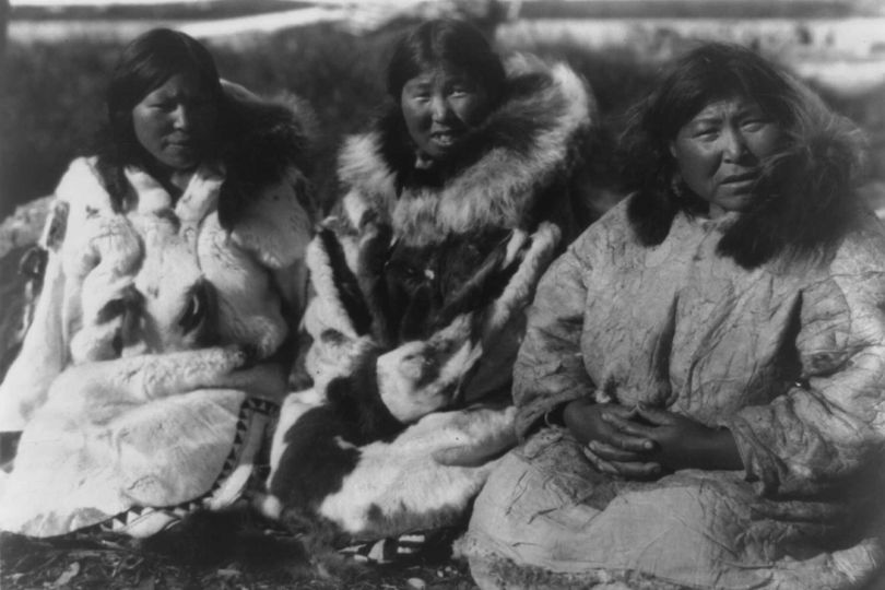 Three Inuit women in fur and skin parkas, Selawik, Alaska, circa 1929. Photograph by Edward Curtis
