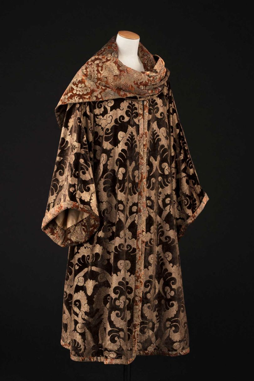 A chocolate-toned silk-velvet coat embossed with caramel-coloured gold thread and a gold silk-satin lining, by Mariano Fortuny from c. 1920